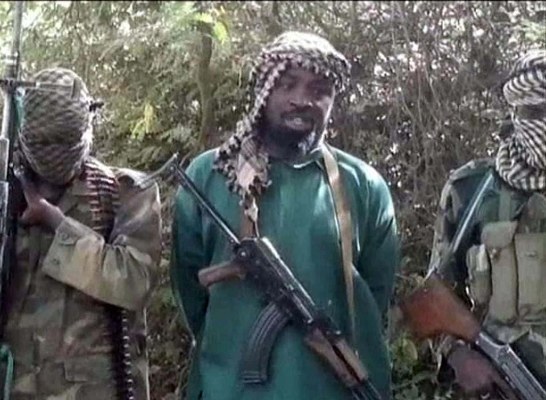Shekau, Boko Haram leader standing between